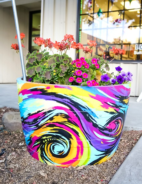 COMMUNITY ART The colorful wine barrel flower planter in front of the Laure Carlisle Art Studio & Gallery is one of about 100 planters decorated by local artists that will adorn the downtown Paso Robles area. - PHOTO BY JAYSON MELLOM