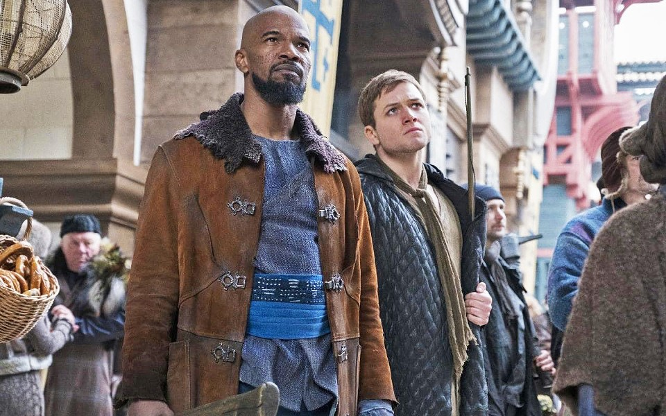 BOYS IN THE HOOD Former Crusader-turned-rebel Robin of Loxley (Taron Edgerton, right) and his Moorish partner, Little John (Jamie Foxx), take on the corrupt British crown, in Robin Hood. - PHOTO COURTESY OF LIONSGATE