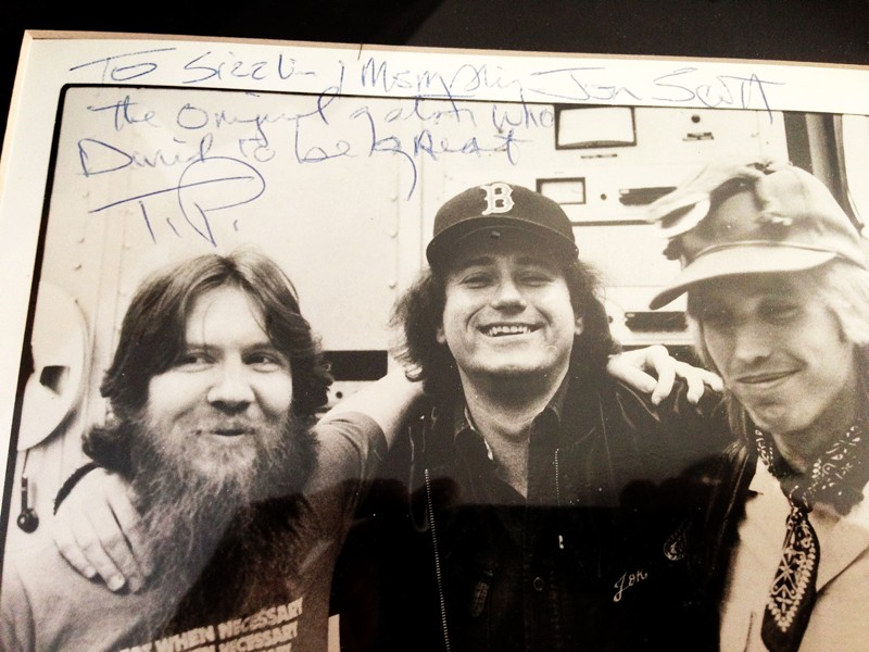A HIGHER PLACE Author Jon Scott (center) and music legend Tom Petty (right) met way back when Scott was working for a record label and Tom Petty and the Heartbreakers were still trying to make it as a band. - PHOTO COURTESY OF JON SCOTT