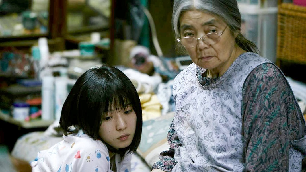 HEARTBREAKER A family of petty thieves helps a child (Miyu Sasaki, left) after finding her outside in the cold and exhibiting signs of abuse, in Shoplifters. - PHOTO COURTESY OF GAGA PICTURES