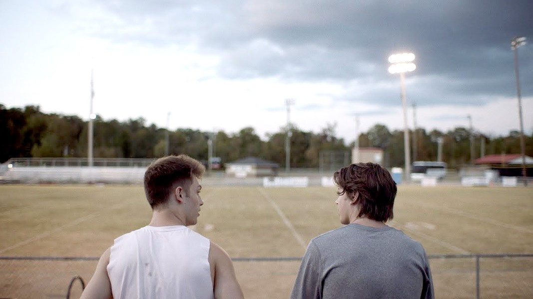 BROTHERS High school runner David (Evan Hofer, left) and his football-playing brother, Zach Truett (Tanner Stine), must persevere through the death of their mother and the abandonment of their father, in the faith-based film, Run the Race, screening exclusively at Downtown Centre. - PHOTO COURTESY OF RESERVE ENTERTAINMENT