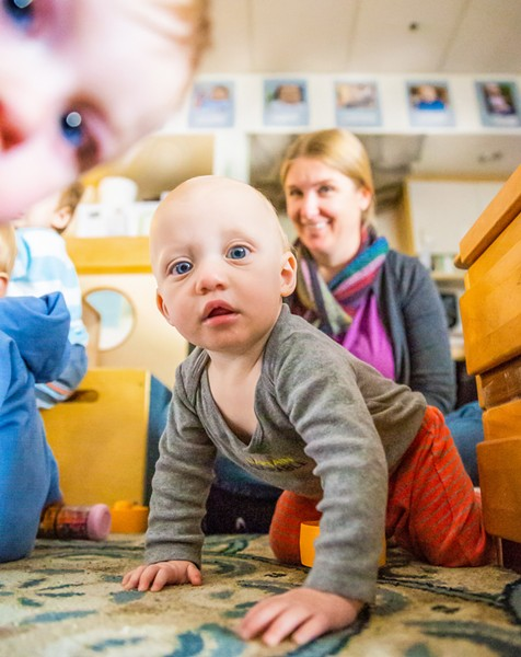 CARE WANTED Nova, who attends the Cal Poly ASI Children's Center, appears intrigued by New Times photographer Jaysom Mellom. Infant care is an often unmet and rapidly growing need in SLO County. - PHOTOS BY JAYSON MELLOM