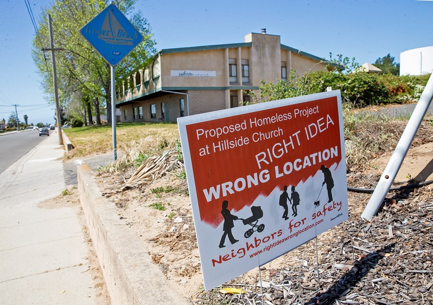 RIGHT IDEA, WHICH LOCATION? Plans for low-income housing and a homeless services complex at Hillside Church in Grover Beach face strong resistance from neighboring residents, who have taken to yard signs to express their opposition. - PHOTO BY JAYSON MELLOM