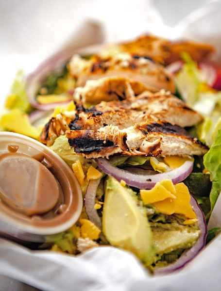 CALI GREENS Citrus marinated grilled chicken, roasted poblano pepper, and applewood bacon marry avocado, tomato, red onion, and aged cheddar—dressed up with cilantro vinaigrette, this is a salad you can sink your teeth into. - PHOTO BY PATRICK IBARRA