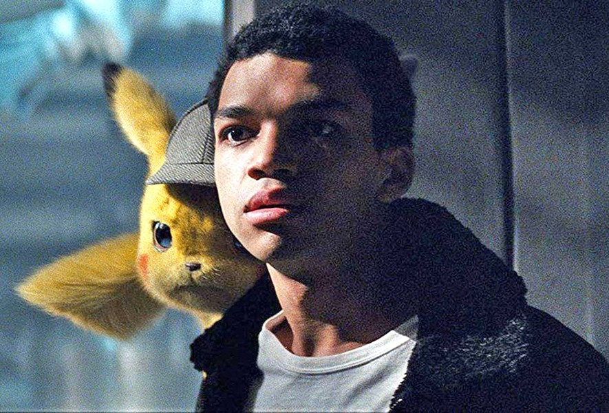 TEAM WORK Detective Pikachu, left, (voiced by Ryan Reynolds) helps Tim Goodman (Justice Smith, right) search for his father, in Pokémon Detective Pikachu. - PHOTOS COURTESY OF LEGENDARY ENTERTAINMENT
