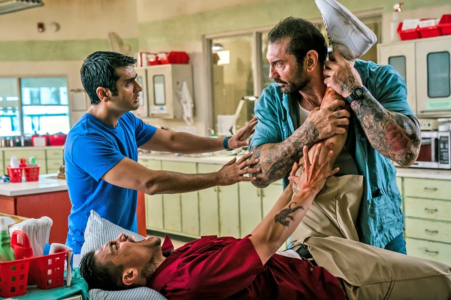 BUDDY FLICK Mild-mannered Uber driver, Stu (Kumail Nanjiani, left), tries to temper his hard-nosed detective passenger, Vic (Dave Bautista, right), as they work together to track down a terrorist, in the comedy action film Stuber. - PHOTO COURTESY OF TWENTIETH CENTURY FOX