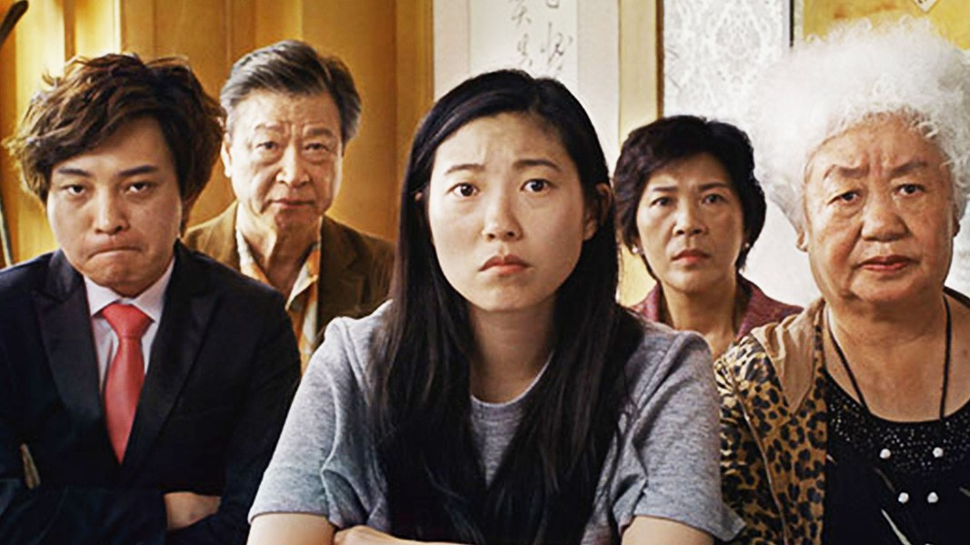 WEDDING/FUNERAL Chinese-American Billi (Awkwafina, center) returns to China when her grandmother is diagnosed with terminal cancer, in The Farewell. - PHOTO COURTESY OF BIG BEACH FILMS