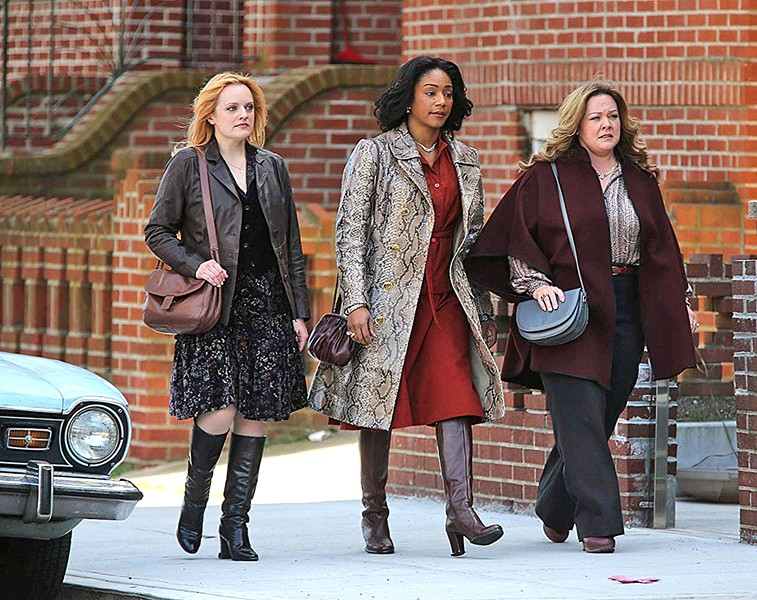 TAKE CHARGE In 1970s New York, three gangsters' wives—(left to right) Claire (Elizabeth Moss), Ruby (Tiffany Haddish), and Kathy (Melissa McCarthy)—decide to continue running their Hell's Kitchen rackets after the men are imprisoned, in The Kitchen. - PHOTO COURTESY OF BRON STUDIOS