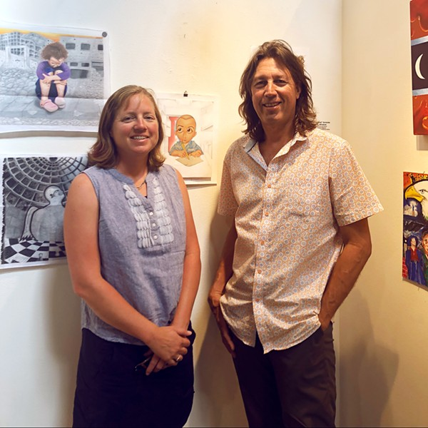 ART FROM THE SOURCE Justice in Justice curators Heather and Kevin Mikelonis stand with a favorite piece of theirs by artist Hugo Gonzalez. Gonzalez's work was discovered through Barrios Unidos, an organization dedicated to providing re-entry opportunities to former prisoners. - PHOTOS BY MALEA MARTIN