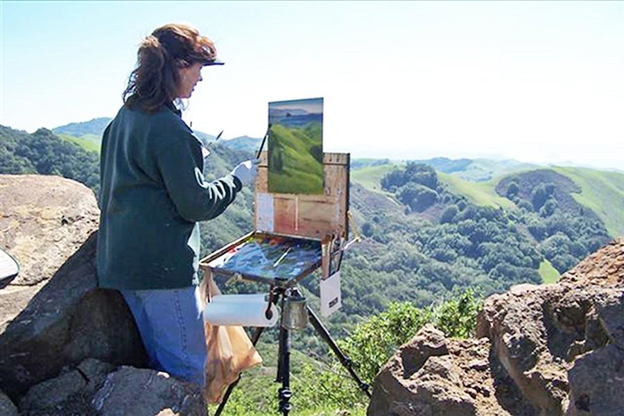ART IN ACTION Sheryl Knight paints a mountainous scene en plein air. - PHOTO COURTESY OF SHERYL KNIGHT