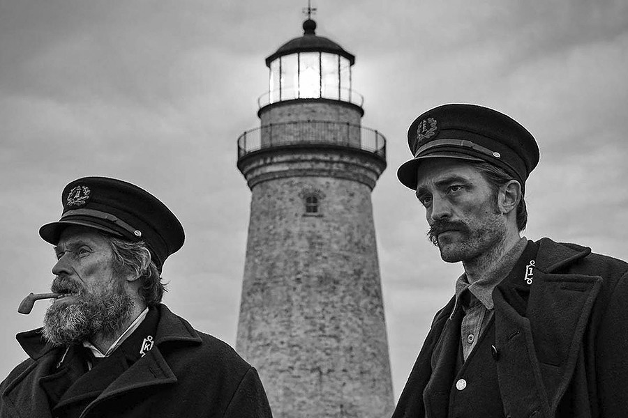MAD WORLD Two men—Thomas Wake (Willem Dafoe, left) and Ephraim Winslow (Robert Pattinson)—find themselves trapped on a remote island together in the hallucinatory black and white horror fantasy, The Lighthouse, screening exclusively at The Palm Theatre. - PHOTO COURTESY OF A24