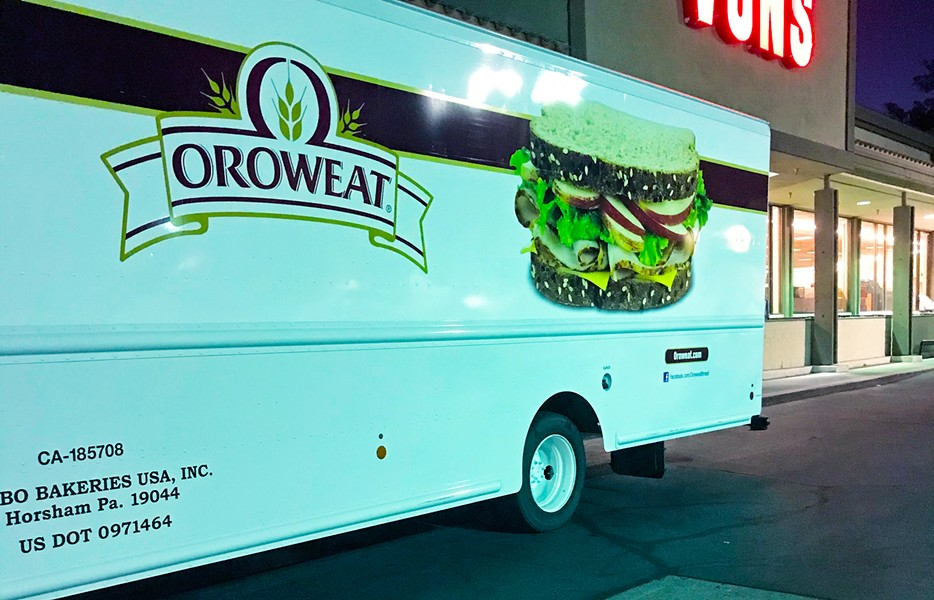 CROSS-COUNTRY FOOD An Oroweat bread truck parked outside Vons in Atascadero in the early morning hours reminds us that high gas prices often mean the price of our food staples will rise too, especially when trucks come over from places like Pennsylvania. - PHOTO BY BETH GIUFFRE