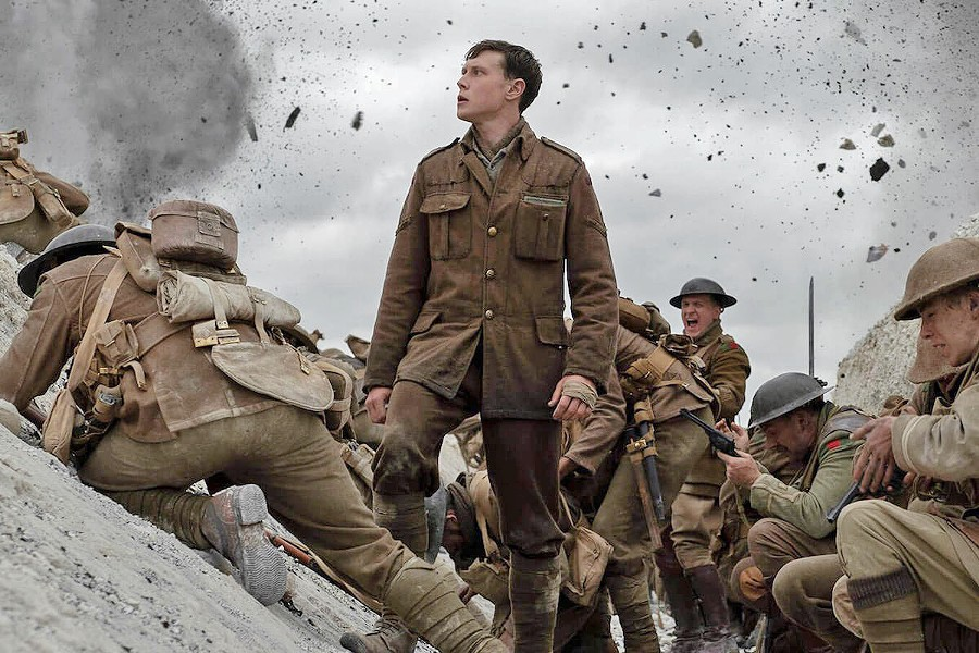 ESSENTIAL MISSION Lance Cpl. Schofield (George MacKay, center) traverses a hellscape in his effort to deliver a message to stop a regiment of his fellow soldiers from charging into a trap. - PHOTOS COURTESY OF DREAMWORKS