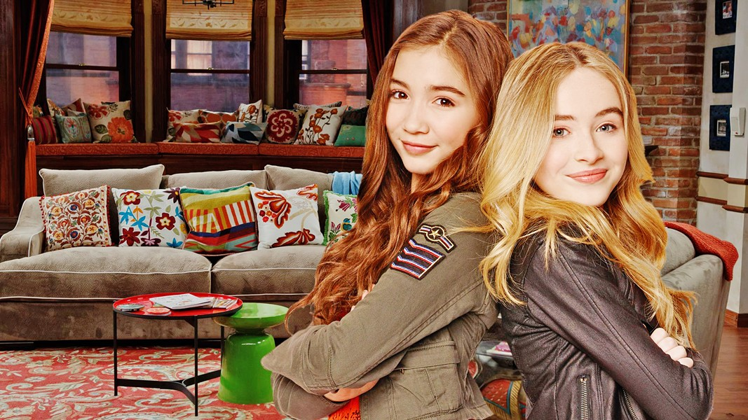 THUNDER! LIGHTNING! In Girl Meets World, Riley Matthews (left)—daughter of Cory Matthews and Topanga Lawrence-Matthews of Boy Meets World fame—and best friend Maya Hart (right) navigate middle school and high school with the help of their friends and family. The show is at once deep, dear, and optimistic. - PHOTO COURTESY OF DISNEY PLUS