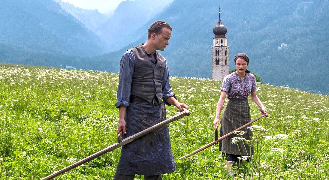 LAST CHANCE! August Diehl (left) stars as Austrian farmer Franz Jägerstätter, a conscientious objector who faces execution for refusing to fight for the Nazis in World War II, in auteur Terrance Malick's A Hidden Life, which leaves the Palm Theatre on Jan. 16. - PHOTO COURTESY OF STUDIO BABELSBERG