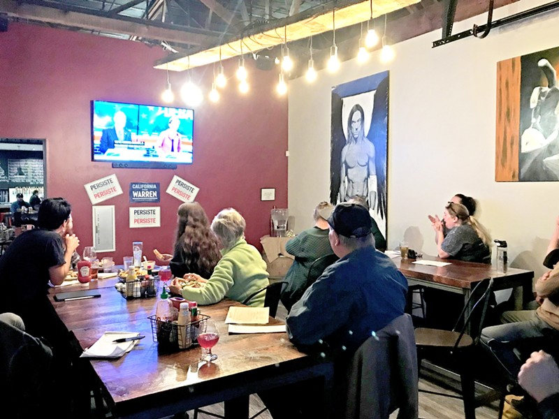 DEBATING Local Warren supporters convene at a debate watch party in Libertine Brewing Company's restaurant in downtown SLO on Feb. 19. - PHOTOS BY JAYSON MELLOM