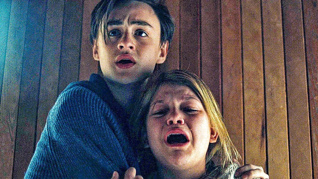 TWISTED Trapped in a snowed-in lodge, two children—Aidan (Jaeden Martell) and Mia (Lia McHugh)—torment their father's new girlfriend, but their game twists out of their control, in The Lodge. - PHOTO COURTESY OF HAMMER FILMS