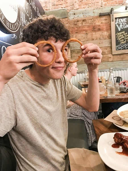 ONION RING SPECTACLES It's okay to play with your food if your mother orders you to illustrate the gigantic size of the Burger Village onion rings. They go really well with the craft cherry coke. - PHOTO BY BETH GIUFFRE