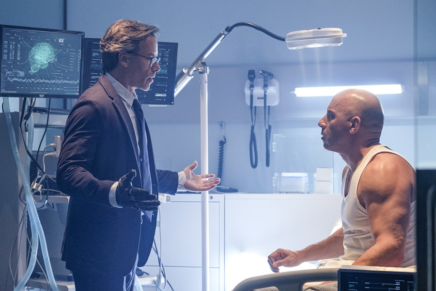 MANIPULATOR Dr. Emil Harting (Guy Pearce, left) resurrects slain soldier Ray Garrison (Vin Diesel) and sexnds him on a series of assassinations under the guise that Garrison is avenging his murdered wife. - PHOTO COURTESY OF SONY PICTURES ENTERTAINMENT
