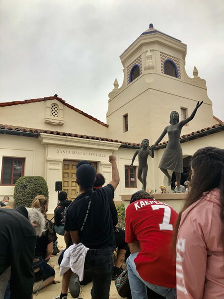 MOMENT OF SILENCE Protestors kneel for eight minutes and 46 seconds of silence in memory of George Floyd outside Santa Maria City Hall. - PHOTO BY MALEA MARTIN