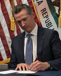 COVID-19 IS EVERYWHERE Gov. Gavin Newsom extended a regional stay-at-home order on Dec. 29 amid a record surge in COVID-19 cases.