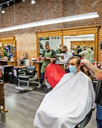 TIME FOR A CUT? Nic Cano cuts Ben Schlesier's hair at The Ritual, which doubles as a men's clothing (and other cool things) store and won Best Barber Shop.