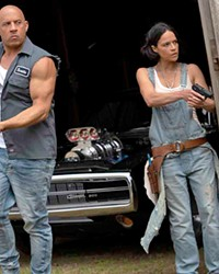 CALL FIRST NEXT TIME Dom (Vin Diesel) and Letty (Michelle Rodriguez) react to unexpected visitors at their secluded home, in F9: The Fast Saga, now screening at local theaters.