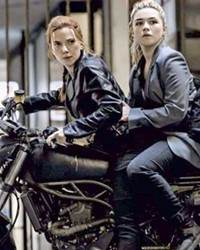 SIBLING RIVALRY Sisters Natasha Romanoff (Scarlett Johansson, left) and Yelena Belova (Florence Pugh, right) have to put aside their differences and work together to save the world from evil, in Black Widow.