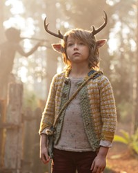 SEARCHING FOR ANSWERS Gus (Christian Convery), a human-deer hybrid, navigates a post-apocalyptic world in search of his origins, in the Netflix TV series Sweet Tooth.
