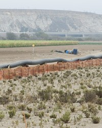 THAT'S A BIG PIPE:  The steel-cased pipeline was welded and pressure tested prior to being dragged through the hole under the riverbed.
