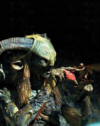 """EFFECTS UNDER ONE ROOF :  Getting the chance to create characters is a special effects companys dream come true. """"Any kind of character or creature of animation is very difficult to get awarded to an untried studio,"""" Visual Effects Producer Ed Irastorza said. Pictured is Doug Jones as The Faun, with one of the fairies created by Cafe FX."""