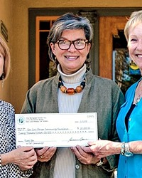 CHECK WRITERS:  The Mortgage House is giving back to the communities it operates in with the help of an endowment fund directed toward helping businesses and students on the Central Coast.