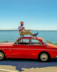 GIVING BACK IN STYLE Ryan Burmaster is president and co-founder of SloRolling, a vintage Volvo group that works on cars and gives back to the community.