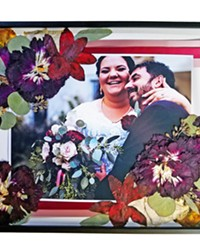 DELICATE BEAUTY Ecobata owner Sarah Presogna creates one of a kind artwork by combining beautifully pressed pieces from her clients wedding bouquet and other sentiments such as photos, vows, and song lyrics. Her work is available through Etsy.