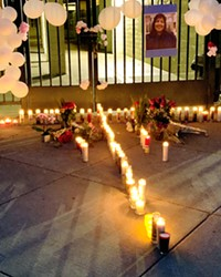 IN MEMORY Students light candles for former San Luis Obispo teacher Andrea Blanco, who passed away in June. Blanco was recognized for her impact in the local Latino community.
