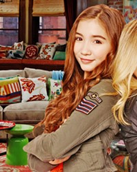 THUNDER! LIGHTNING! In Girl Meets World, Riley Matthews (left)—daughter of Cory Matthews and Topanga Lawrence-Matthews of Boy Meets World fame—and best friend Maya Hart (right) navigate middle school and high school with the help of their friends and family. The show is at once deep, dear, and optimistic.
