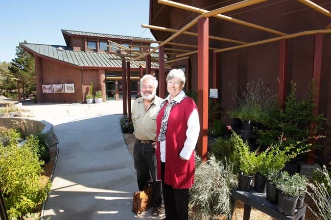 REASON TO SMILE :  SLO Botanical Garden Development Director Liz Scott Graham and architect Ken Haggard, who designed the garden's self-sustaining buildings in the background, muse about the dramatic expansion planned for the site.**** - PHOTO BY STEVE E. MILLER