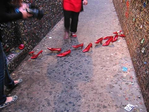 BUBBLEGUM ALLEY INSTALLATION :  The Nothing Happened Here duo added some color to Bubblegum Alley with a shoe installation on Aug. 23. - PHOTO BY MIGNON KHARGIE