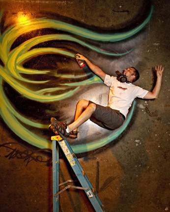 THE BRINK OF DISASTER! :  Graffiti artist Derek Brown teeters on the edge of certain unhappiness. - PHOTO BY STEVE E. MILLER