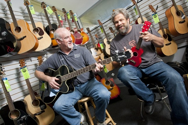 THE DAY THE MUSIC THRIVED :  Floor Manager Andy Morris (left) and owner Dan Ernst have relocated Grand Central Music Conservatory to a smaller but more functional space. - PHOTO BY STEVE E. MILLER