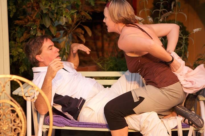 STAGE STRIP :  Rosie Pye (Britta Swearingen) attempts to seduce Felix Humble (David Norum) in his mother's English garden. - PHOTO BY STEVE E. MILLER