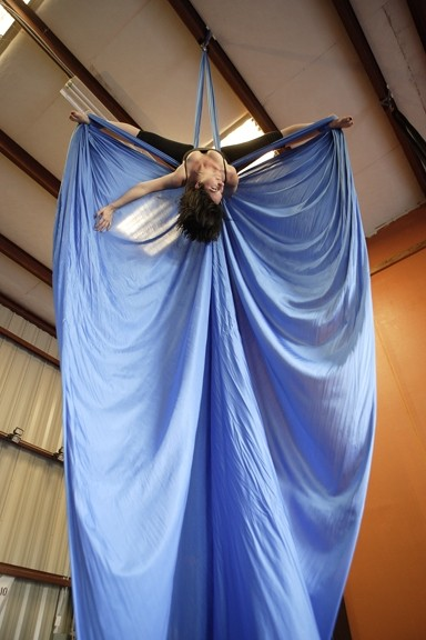 AERIAL ANGEL :  Hailley teaches aerial dancing with Suspended Motion at World Rhythm and Motion Studio. - PHOTO BY STEVE E. MILLER