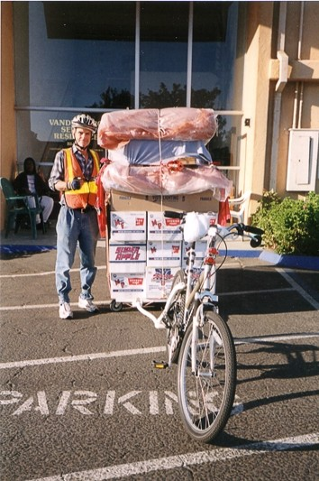 THE BIG MOVE: :  James Stoughton designed and built a hitch and wagon so he could move an entire apartment's worth of stuff—11 trips at 650 pounds a load—with his bike. - PHOTO COURTESY KAY STOUGHTON