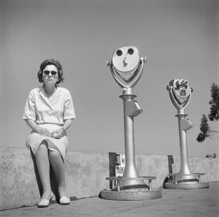 COIN-OPERATED TWIN :  While many street photographers avoided interacting with their subjects, Tress would occasionally direct people to create a desired composition, such as this one. - PHOTO BY ARTHUR TRESS