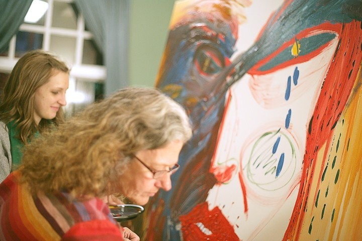TAG TEAM :  Abby Berger (left) and Sandra Pendell team up to whip the group painting into shape. - PHOTO BY GLEN STARKEY