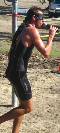 MC RUNNSALOT :  After running the 5K on a lark, machine-man Chris Stehula helped announce the race.