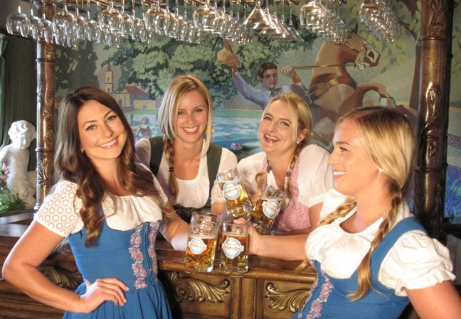 CHEERS AND 'BIERS':  The Madonna Inn 'Dirndl Girls' won't be the only ones dressed up for Madonna Inn and Firestone Walker's inaugural Oktoberfest this Saturday, Oct. 11. Firestone Walker Brewmaster Matt Brynildson plans to rock his own authentic lederhosen as the crowd chows down on traditional German grub. - PHOTO COURTESY OF MADONNA INN