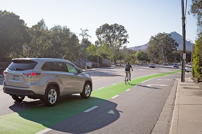 "GREEN LANES:  SLO hopes to introduce more ""protected bike lanes,"" such as this stretch on California Boulevard, to separate bikers from high-speed traffic. - PHOTO BY KAORI FUNAHASHI"