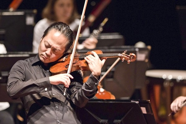 LEADER OF THE PACK:  Music Director Scott Yoo is both a renowned conductor and performer. He began playing violin at age 3 and has since conducted all over the world, in places as varied as Chicago, London, Mexico, and Japan. - PHOTO BY BRIAN P. LAWLER