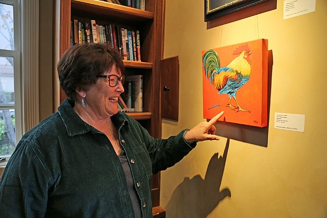 CHICKEN, IT'S WHAT'S FOR ART:  Ethel Landers, the volunteer art gallery curator for the GALA Center in San Luis Obispo, stands by her oil painting, Lost it in a tiff, which features a chicken that has lost a feather. The piece is currently hanging in the gallery on Palm Street. - PHOTO BY DYLAN HONEA-BAUMANN
